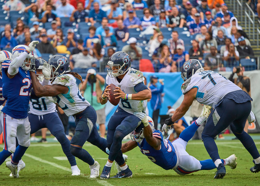 Tennessee Titans quarterback Marcus Mariota (8) tries to avoid another sack while offensive tackle Taylor Lewan (77) tries to protect his blind side in the second half of an NFL game Sunday, Oct. 6, 2019, at Nissan Stadium in Nashville, Tenn.