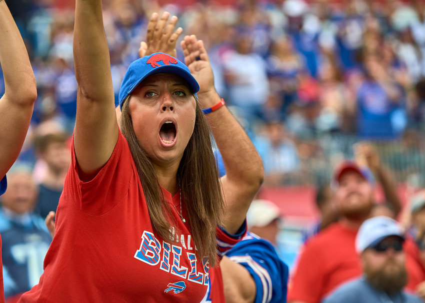 A Buffalo Bills fan cheers on her team during the first half of an NFL game between the Bills and the Tennessee Titans Sunday, Oct. 6, 2019, at Nissan Stadium in Nashville, Tenn.