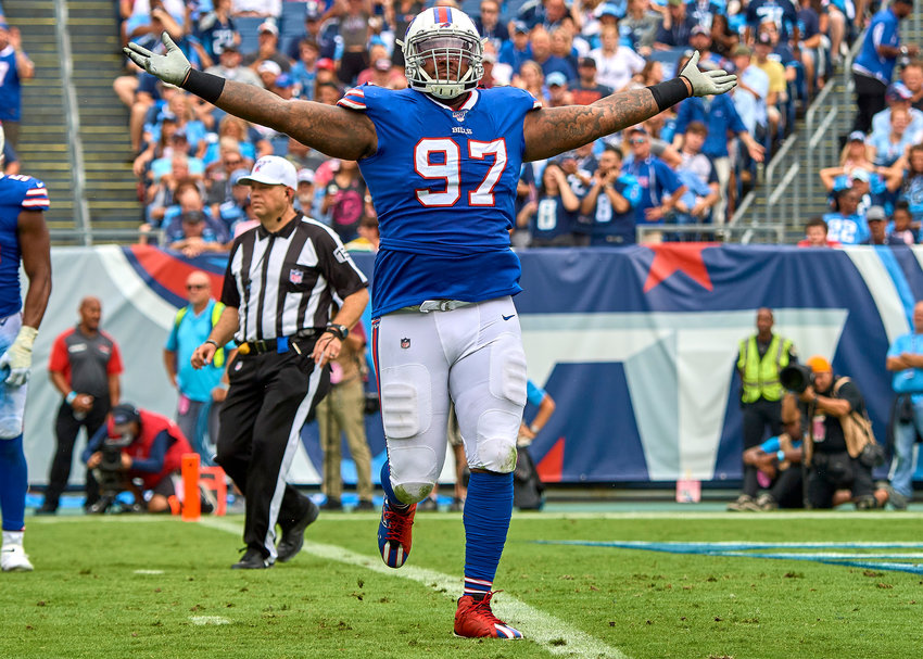 Buffalo Bills defensive tackle Jordan Phillips (97) celebrates his sack of Tennessee Titans quarterback Marcus Mariota (8) in the first half of an NFL game Sunday, Oct. 6, 2019, at Nissan Stadium in Nashville, Tenn.