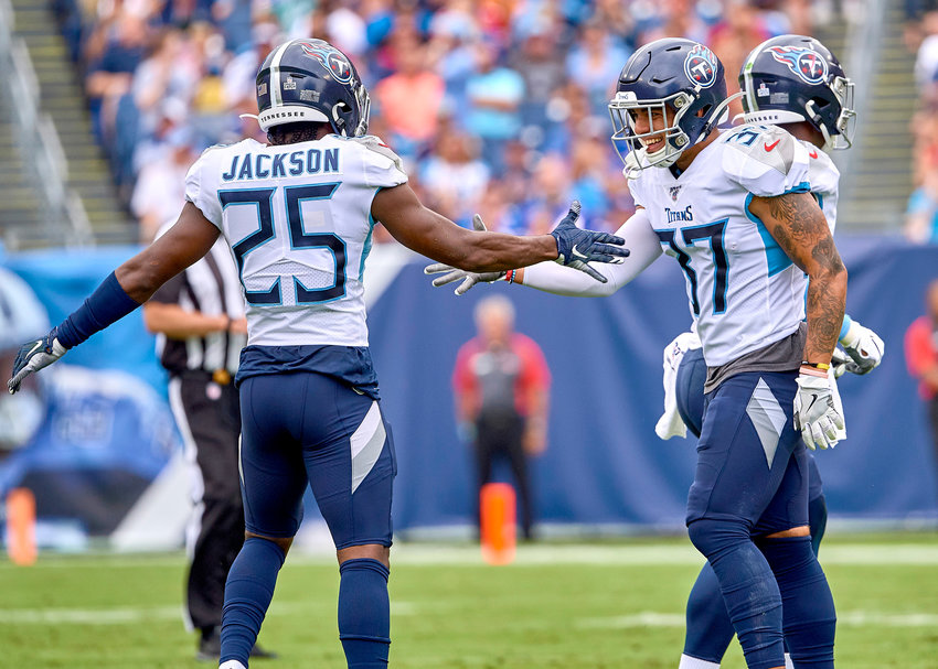 Tennessee Titans cornerback Adoree' Jackson (25) and defensive back Amani Hooker (37) celebrate a stop during the first half of an NFL game between the Buffalo Bills and the Titans Sunday, Oct. 6, 2019, at Nissan Stadium in Nashville, Tenn.