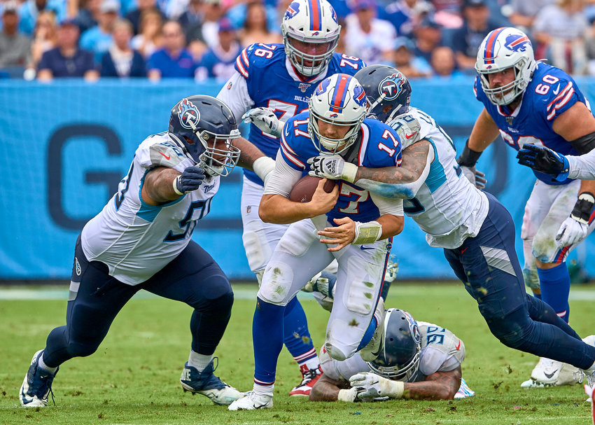 Buffalo Bills quarterback Josh Allen (17) is escapes the grasp of Tennessee Titans defensive end Jurrell Casey (99) but is tackled by linebacker Harold Landry (58) during the first half of an NFL game Sunday, Oct. 6, 2019, at Nissan Stadium in Nashville, Tenn.