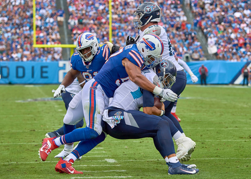 Tennessee Titans quarterback Marcus Mariota (8) is sacked by Buffalo Bills outside linebacker Lorenzo Alexander (57) during the first half of an NFL game Sunday, Oct. 6, 2019, at Nissan Stadium in Nashville, Tenn.