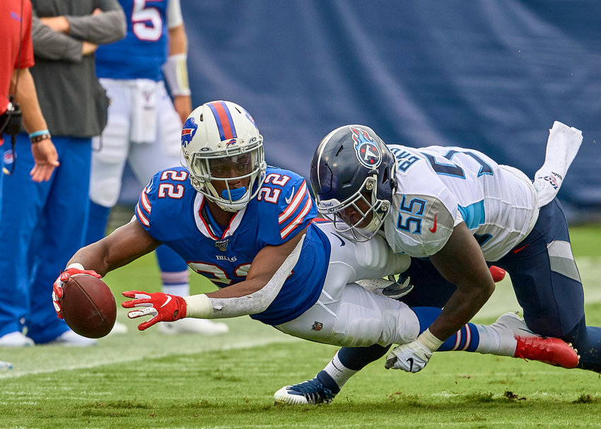 Buffalo Bills running back T.J. Yeldon (22) reaches for extra yards while being tackled by Tennessee Titans inside linebacker Jayon Brown (55) during the first half of an NFL game Sunday, Oct. 6, 2019, at Nissan Stadium in Nashville, Tenn.