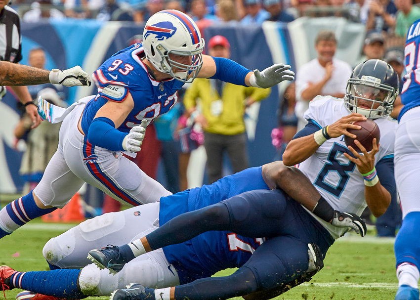 Tennessee Titans quarterback Marcus Mariota (8) is tackled during the first half of an NFL game between the Buffalo Bills and the Titans Sunday, Oct. 6, 2019, at Nissan Stadium in Nashville, Tenn.