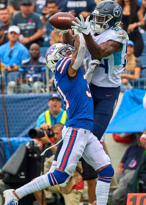Tennessee Titans wide receiver Corey Davis (84) and Buffalo Bills strong safety Dean Marlowe (31) battle for a pass intended for Davis during the first half of an NFL game Sunday, Oct. 6, 2019, at Nissan Stadium in Nashville, Tenn.