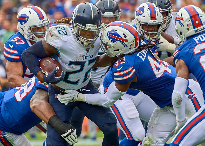 Tennessee Titans running back Derrick Henry (22) looks for an opening in the Buffalo Bills defense during the first half of an NFL game Sunday, Oct. 6, 2019, at Nissan Stadium in Nashville, Tenn.