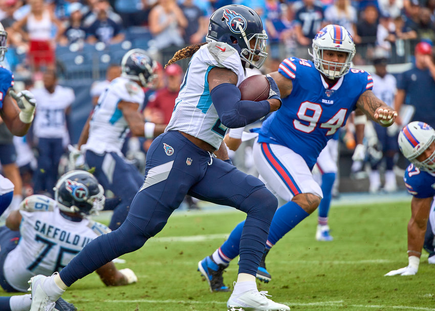 Tennessee Titans running back Derrick Henry (22) on a big run around the end during the first half of an NFL game between the Buffalo Bills and the Titans Sunday, Oct. 6, 2019, at Nissan Stadium in Nashville, Tenn.