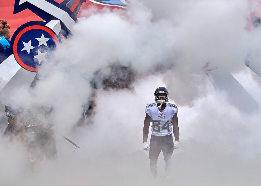 Tennessee Titans wide receiver Corey Davis (84) makes a dramatic entrance prior to the start of an NFL game between the Buffalo Bills and the Tennessee Titans Sunday, Oct. 6, 2019, at Nissan Stadium in Nashville, Tenn.