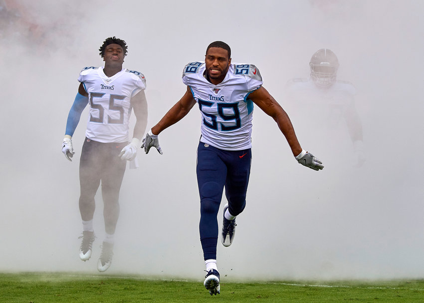 Tennessee Titans inside linebackers Wesley Woodyard (59)  and Jayon Brown (55) are seen during player introductions prior to the kickoff of an NFL game between the Buffalo Bills and the Titans Sunday, Oct. 6, 2019, at Nissan Stadium in Nashville, Tenn.
