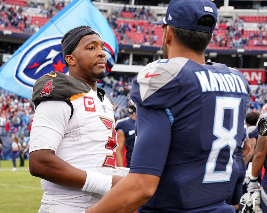 Tennessee Titans quarterback Marcus Mariota (8) and Tampa Bay Buccaneers quarterback Jameis Winston (3), both former Heisman Trophy winners, shake hands at midfield following an NFL football game Sunday, Oct. 27, 2019, at Nissan Stadium in Nashville, Tenn.