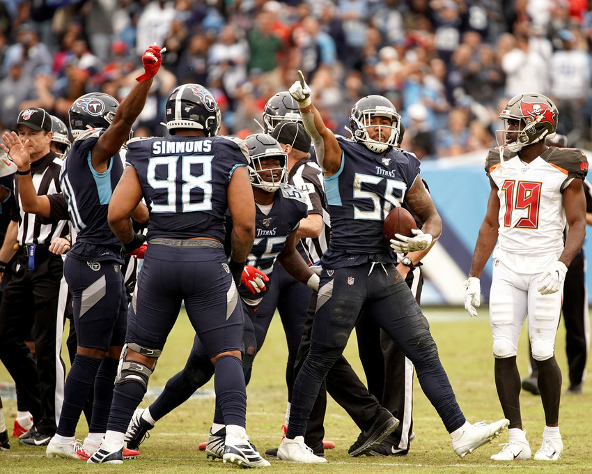 Tennessee Titans linebacker Harold Landry (58) forces and recovers a fumble in the second half of an NFL football game against the Tampa Bay Buccaneers Sunday, Oct. 27, 2019, at Nissan Stadium in Nashville, Tenn.