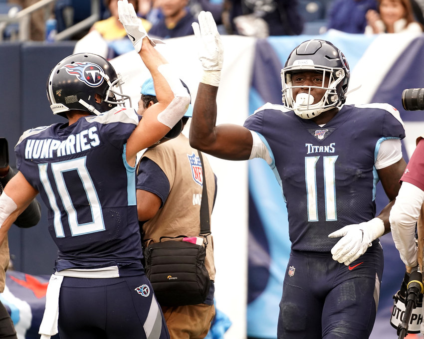 Tennessee Titans wide receiver A.J. Brown (11) celebrates his touchdown with Tennessee Titans wide receiver Adam Humphries (10) in the second half of an NFL football game against the Tampa Bay Buccaneers Sunday, Oct. 27, 2019, at Nissan Stadium in Nashville, Tenn.