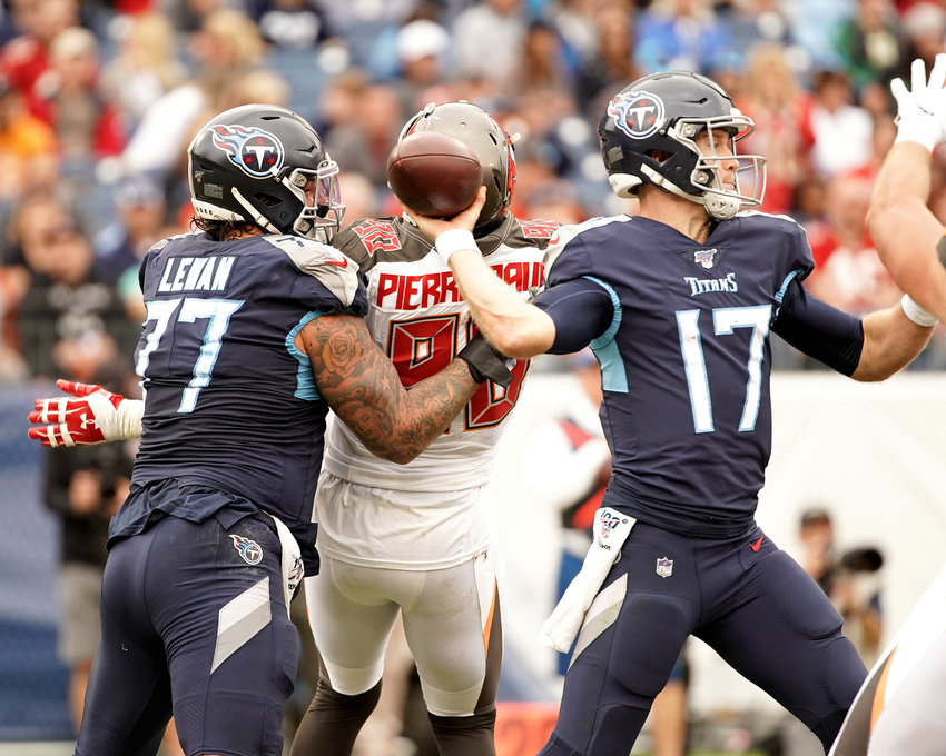 Tennessee Titans offensive tackle Taylor Lewan (77) protects the blind side of quarterback Ryan Tannehill (17) from Tampa Bay Buccaneers linebacker Jason Pierre-Paul (90) in the second half of an NFL football game against the Tampa Bay Buccaneers Sunday, Oct. 27, 2019, at Nissan Stadium in Nashville, Tenn.