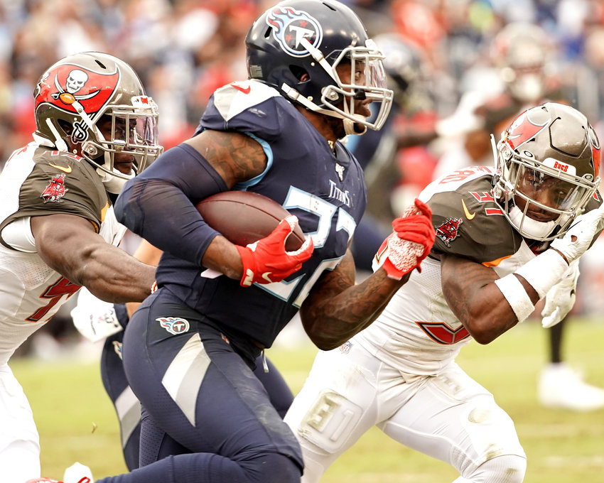 Tennessee Titans running back Derrick Henry (22) with a long run for a first down in the second half of an NFL football game against the Tampa Bay Buccaneers Sunday, Oct. 27, 2019, at Nissan Stadium in Nashville, Tenn.