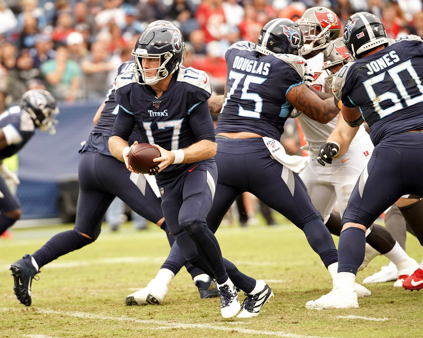 Tennessee Titans quarterback Ryan Tannehill (17) prepares to hand off the ball in the second half of an NFL football game against the Tampa Bay Buccaneers Sunday, Oct. 27, 2019, at Nissan Stadium in Nashville, Tenn.