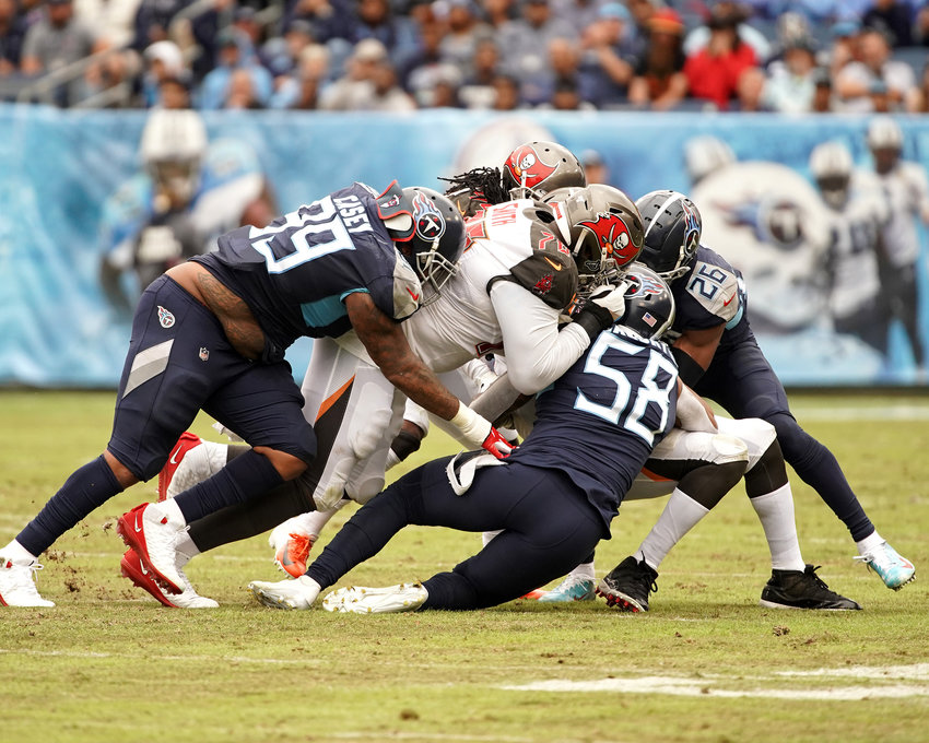 Tennessee Titans defensive end Jurrell Casey (99), linebacker Harold Landry (58) and cornerback Logan Ryan (26) make the stop in the second half of an NFL football game against the Tampa Bay Buccaneers Sunday, Oct. 27, 2019, at Nissan Stadium in Nashville, Tenn.