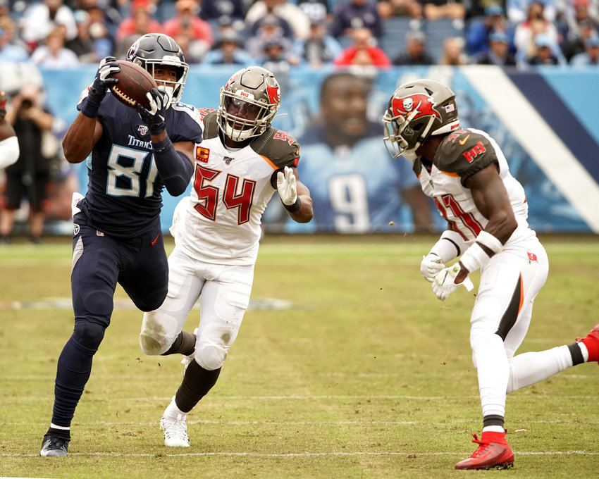 Tennessee Titans tight end Jonnu Smith (81) with a catch in stride in the second half of an NFL football game against the Tampa Bay Buccaneers Sunday, Oct. 27, 2019, at Nissan Stadium in Nashville, Tenn.