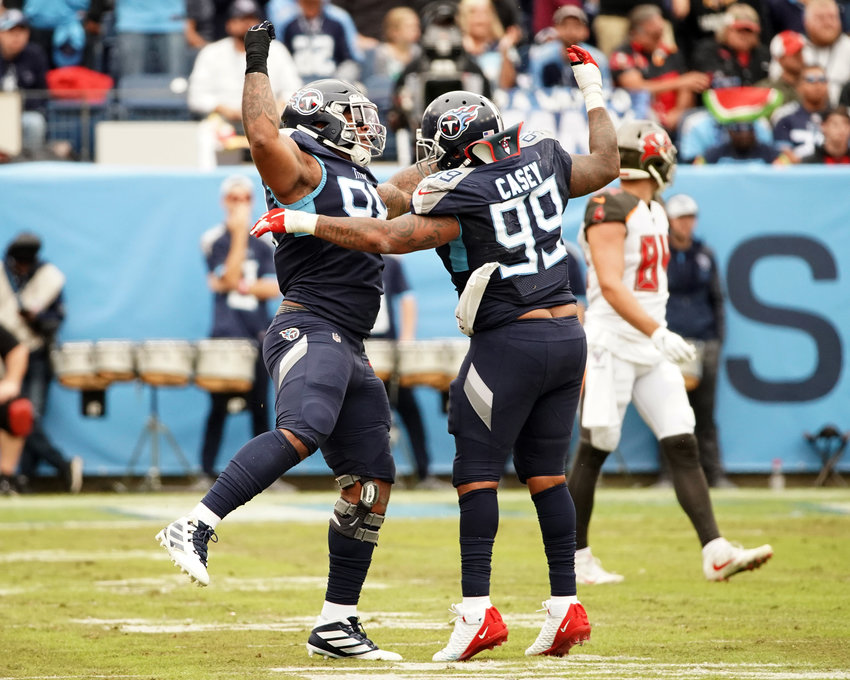 Tennessee Titans defensive tackle Jeffery Simmons (98) tackle and defensive end Jurrell Casey (99) celebrate a stop during the first half of an NFL football game against the Tampa Bay Buccaneers Sunday, Oct. 27, 2019, at Nissan Stadium in Nashville, Tenn.