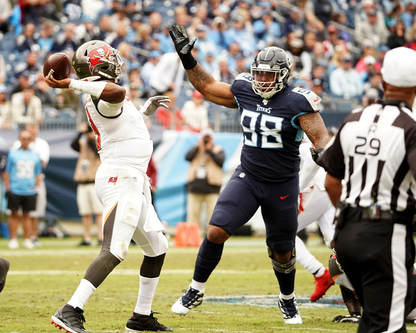Tampa Bay Buccaneers quarterback Jameis Winston (3) drops back to pass under pressure from Tennessee Titans defensive tackle Jeffery Simmons (98) during the first half of an NFL football game Sunday, Oct. 27, 2019, at Nissan Stadium in Nashville, Tenn.
