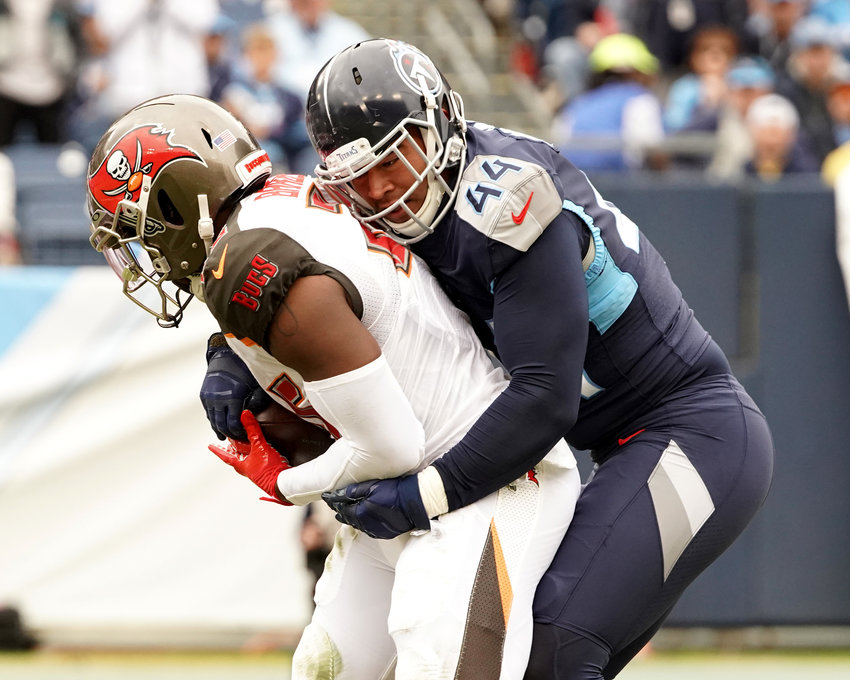 Tampa Bay Buccaneers running back Peyton Barber (25) doesn't get far against Tennessee Titans outside linebacker Kamalei Correa (44) during an NFL football game Sunday, Oct. 27, 2019, at Nissan Stadium in Nashville, Tenn.