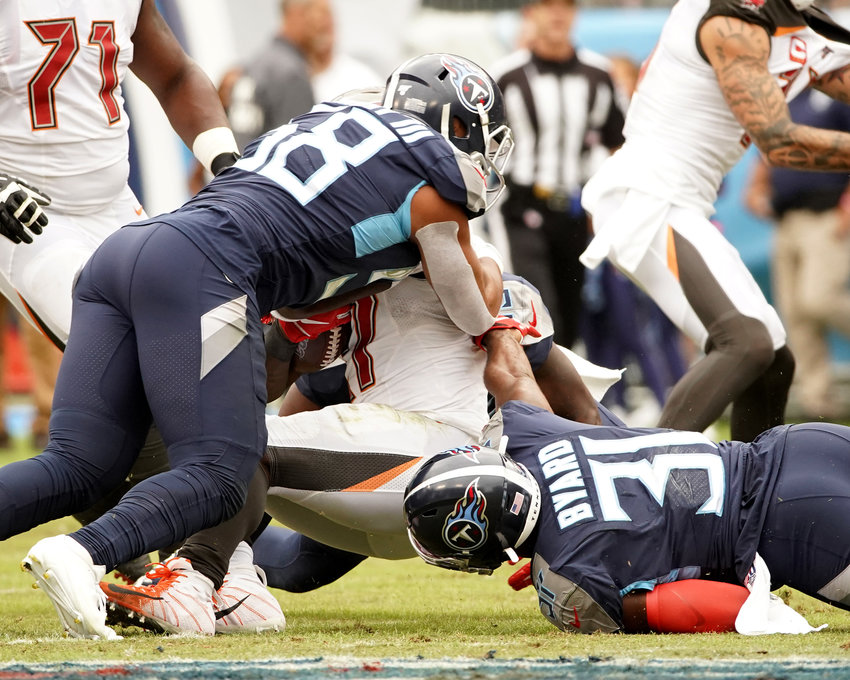 Tennessee Titans linebacker Harold Landry III (58) and free safety Kevin Byard (31) with a stop in an NFL football game against the Tampa Bay Buccaneers Sunday, Oct. 27, 2019, at Nissan Stadium in Nashville, Tenn.
