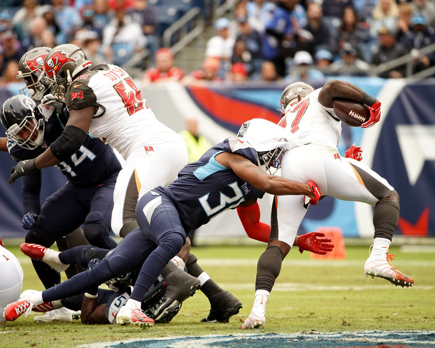Tennessee Titans free safety Kevin Byard (31) tackles Tampa Bay Buccaneers running back Ronald Jones (27) in the first half of an NFL football game Sunday, Oct. 27, 2019, at Nissan Stadium in Nashville, Tenn.