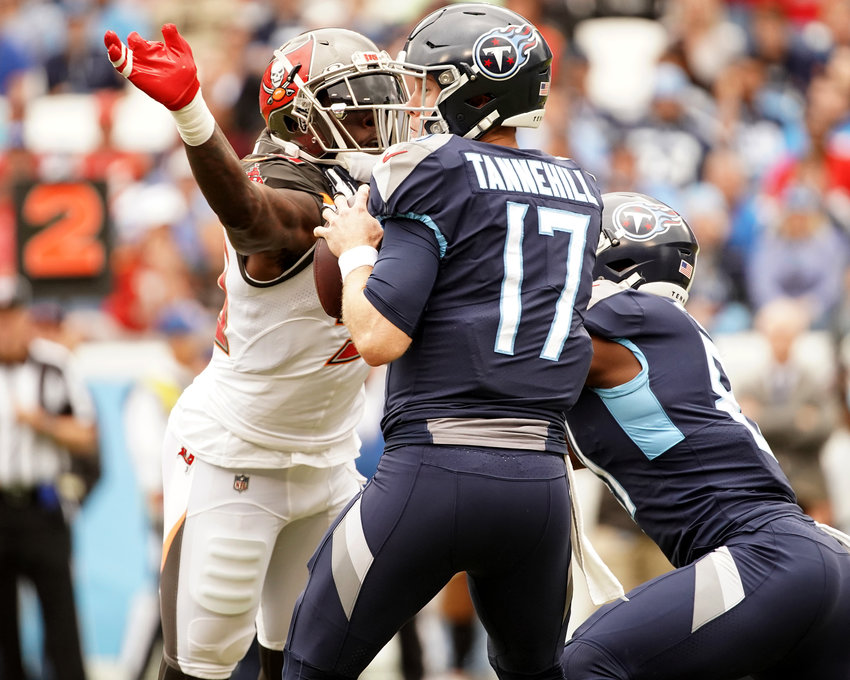 Tennessee Titans quarterback Ryan Tannehill (17) drops back to pass under pressure during the first half of an NFL football game against the Tampa Bay Buccaneers Sunday, Oct. 27, 2019, at Nissan Stadium in Nashville, Tenn.