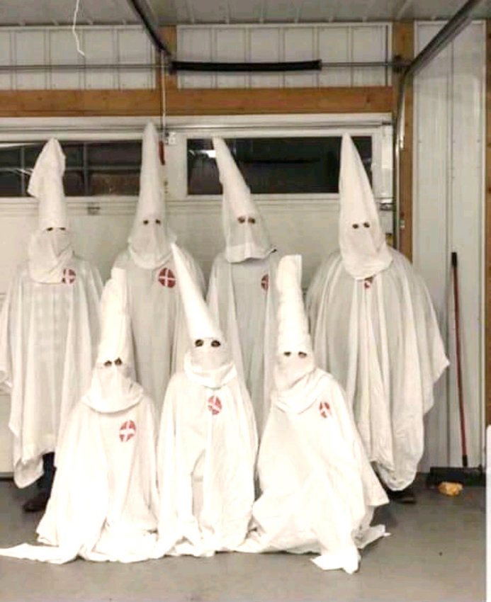A group of individuals dressed in Ku Klux Klan regalia on Halloween night in Jamestown. These seven individuals were reportedly part of it. The photo was provided by Rene Martinez, who captured it from social media.