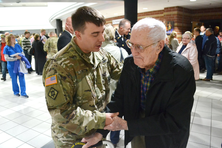 "Staff Sgt. Stephen Livingston shakes hands with World War II veteran Ross Williams during Thursday's veterans program at Cookeville High School. Williams, who will turn 96 in January, was a  PFC in World War II, serving ""all the way from Africa to Nuremberg."""