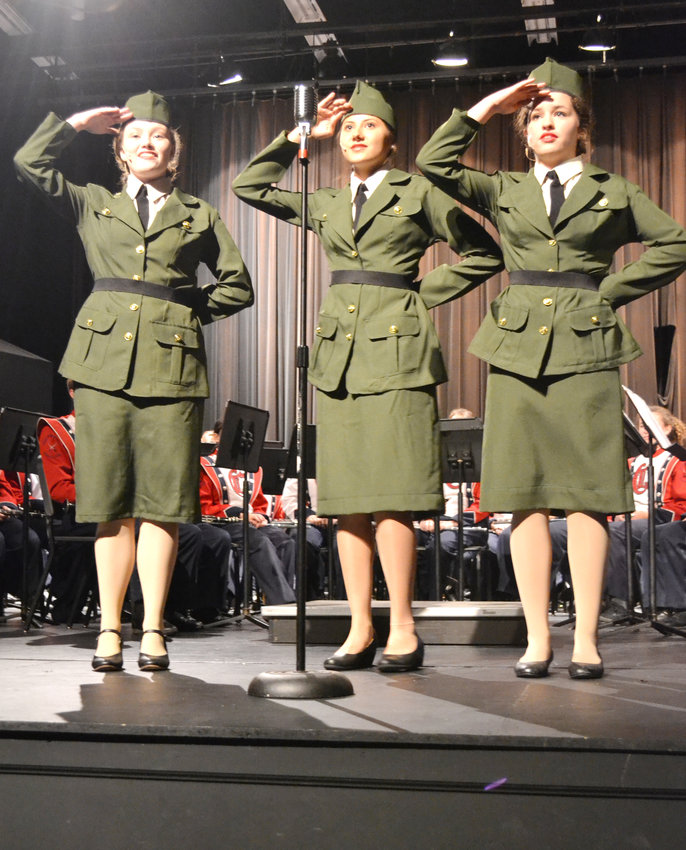 "Elizabeth Andrews, Aasta Thurman and Faith Clemons portray the Andrews Sisters singing ""Boogie Woogie Bugle Boy"" during Thursday's Veterans Program at Cookeville High School."