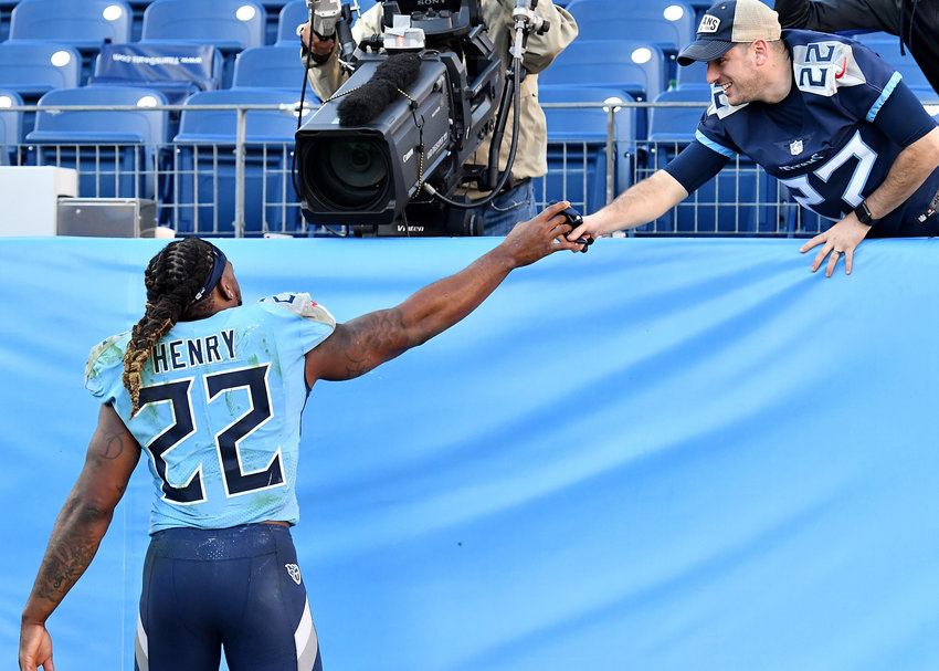 Tennessee Titans running back Derrick Henry (22) gives a glove to a fan following the Titans' win against the Kansas City Chiefs Sunday, Nov. 10, 2019, at Nissan Stadium in Nashville, Tenn.