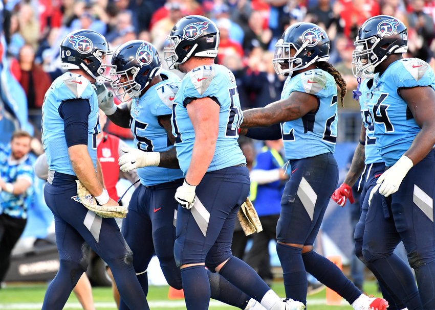 Tennessee Titans quarterback Ryan Tannehill (17) call his number for the two-point conversion and celebrates late in the fourth quarter of the game against the Kansas City Chiefs Sunday, Nov. 10, 2019, at Nissan Stadium in Nashville, Tenn.