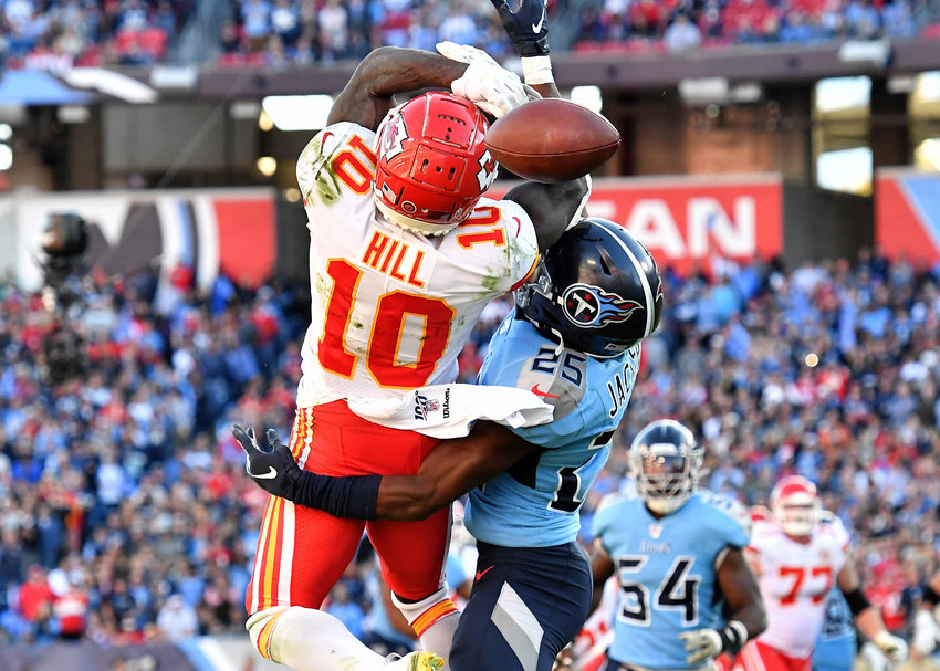 Tennessee Titans cornerback Adoree' Jackson (25) breaks up a crucial pass intended for Kansas City Chiefs wide receiver Tyreek Hill (10) late in the fourth quarter of the game Sunday, Nov. 10, 2019, at Nissan Stadium in Nashville, Tenn.