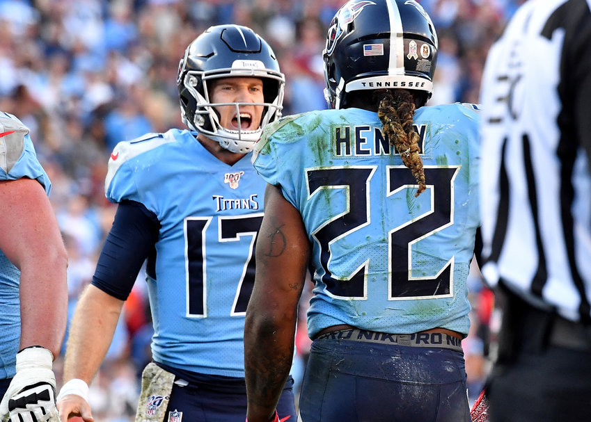 Tennessee Titans quarterback Ryan Tannehill (17) reacts to running back Derrick Henry's (22) run late in the fourth quarter of the game against the Kansas City Chiefs Sunday, Nov. 10, 2019, at Nissan Stadium in Nashville, Tenn.