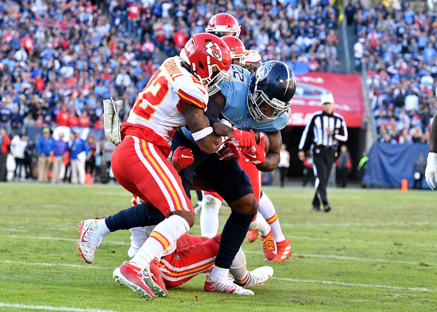 Tennessee Titans running back Derrick Henry (22) on his way to a first down in the fourth quarter of the game against the Kansas City Chiefs Sunday, Nov. 10, 2019, at Nissan Stadium in Nashville, Tenn.