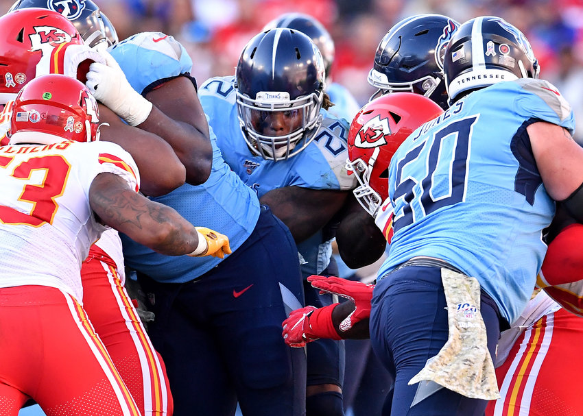Tennessee Titans running back Derrick Henry (22) looks for room to get up the middle in the second half of an NFL football game against the Kansas City Chiefs at Nissan Stadium in Nashville, Tenn., Sunday, Nov. 10, 2019.