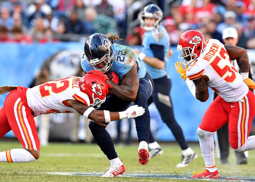 Tennessee Titans running back Derrick Henry (22) is tackled after a handoff in the second half of an NFL football game against the Kansas City Chiefs at Nissan Stadium in Nashville, Tenn., Sunday, Nov. 10, 2019.