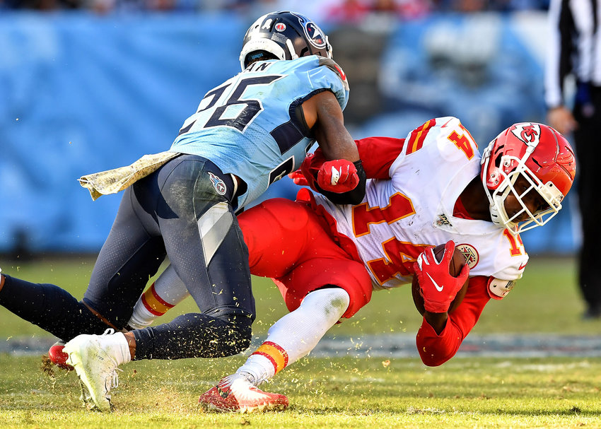 Tennessee Titans cornerback Adoree' Jackson (25) puts a hit on Kansas City Chiefs wide receiver Sammy Watkins (14) in the second half of the game Sunday, Nov. 10, 2019, at Nissan Stadium in Nashville, Tenn.
