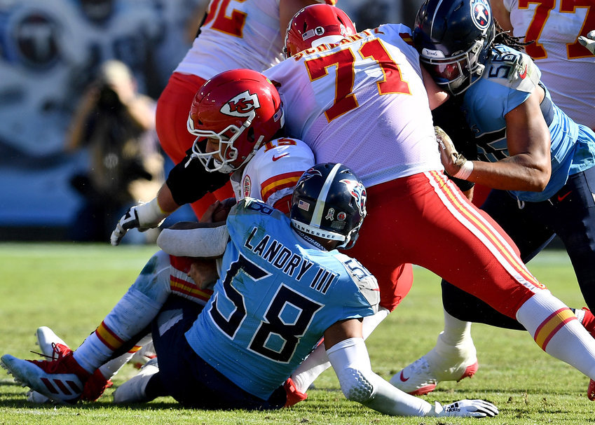 Kansas City Chiefs quarterback Patrick Mahomes (15) is sacked by Tennessee Titans linebacker Harold Landry (58) in the first half of the game Sunday, Nov. 10, 2019, at Nissan Stadium in Nashville, Tenn.