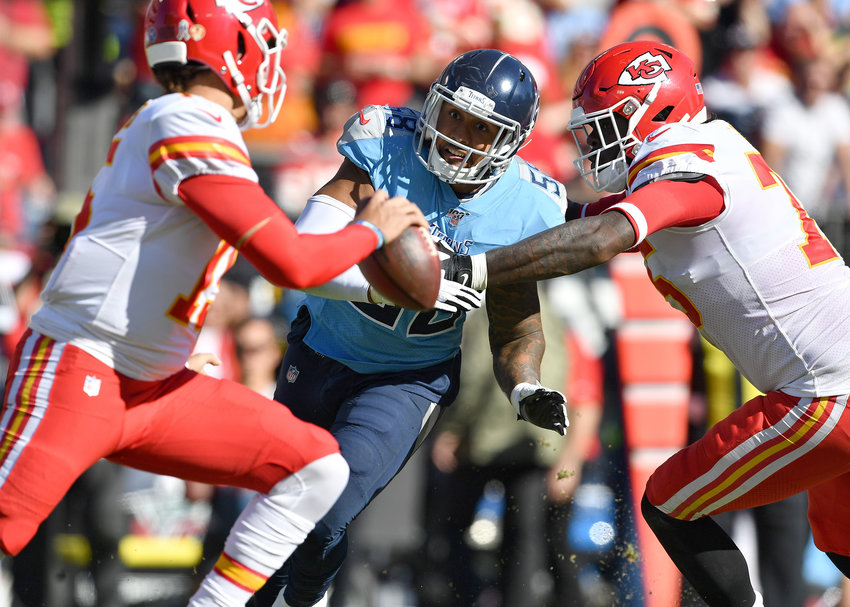 Tennessee Titans linebacker Harold Landry (58) gets through to put pressure on Kansas City Chiefs quarterback Patrick Mahomes (15) during the first half of the game between Sunday, Nov. 10, 2019, at Nissan Stadium in Nashville, Tenn.