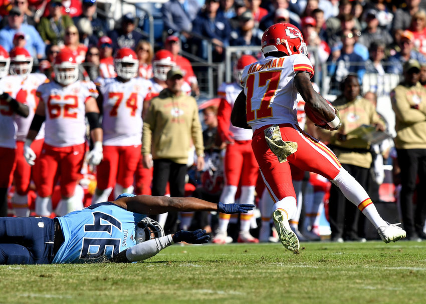 Tennessee Titans defensive back Joshua Kalu (46) can't hold onto Kansas City Chiefs wide receiver Mecole Hardman (17) during the first half of the game Sunday, Nov. 10, 2019, at Nissan Stadium in Nashville, Tenn.