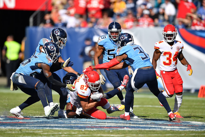 The Tennessee Titans defense closes in on Kansas City Chiefs tight end Travis Kelce (87) in the first half of the game Sunday, Nov. 10, 2019, at Nissan Stadium in Nashville, Tenn.