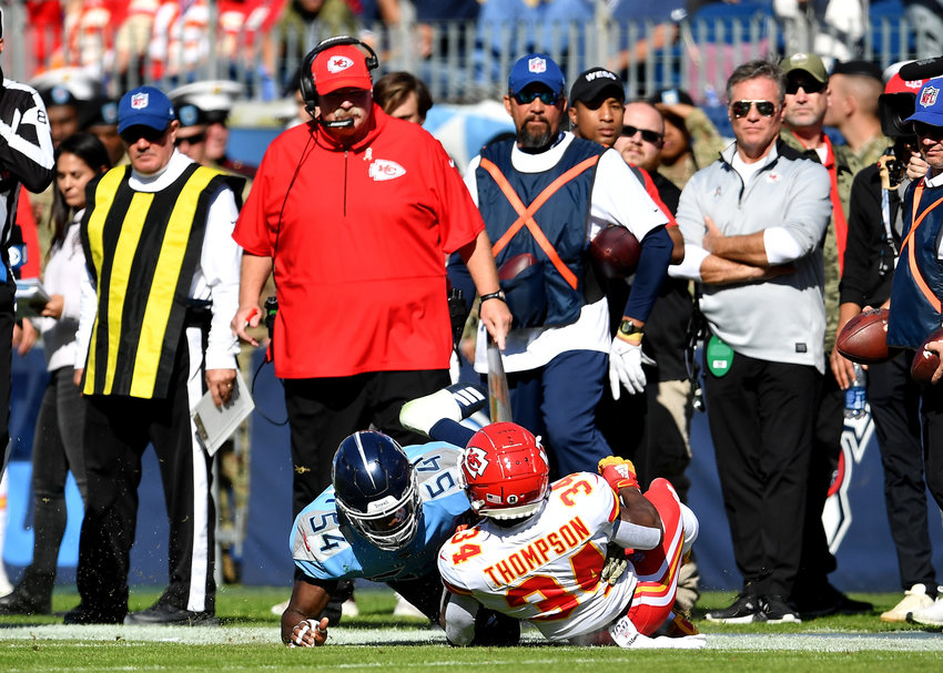Tennessee Titans inside linebacker Rashaan Evans (54) tackles Kansas City Chiefs running back Darwin Thompson (34) as Chiefs head coach Andy Reid looks on Sunday, Nov. 10, 2019, at Nissan Stadium in Nashville, Tenn.