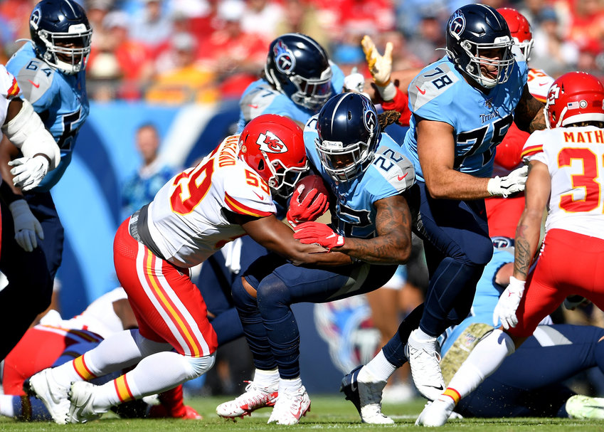 Tennessee Titans running back Derrick Henry (22) is tackled by Kansas City Chiefs defensive end Frank Clark (55) in the first half of the game Sunday, Nov. 10, 2019, at Nissan Stadium in Nashville, Tenn.