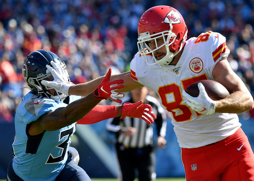 Tennessee Titans free safety Kevin Byard (31) gets a stiff-arm from Kansas City Chiefs tight end Travis Kelce (87) in the first quarter of the NFL football game Sunday, Nov. 10, 2019, at Nissan Stadium in Nashville, Tenn.