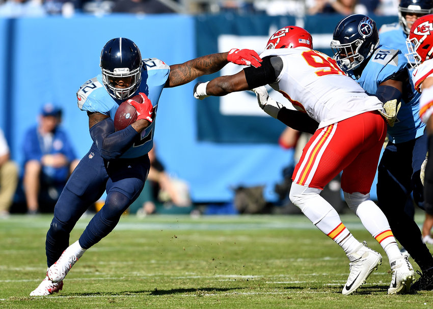 Tennessee Titans running back Derrick Henry (22) works his way around the end in the first half of an NFL football game against the Kansas City Chiefs at Nissan Stadium in Nashville, Tenn., Sunday, Nov. 10, 2019.