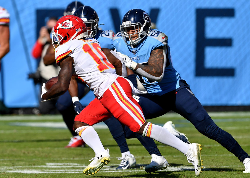 Tennessee Titans linebacker Harold Landry (58) tries to catch Kansas City Chiefs wide receiver Tyreek Hill (10) early in the first quarter of an NFL football game Sunday, Nov. 10, 2019, at Nissan Stadium in Nashville, Tenn.