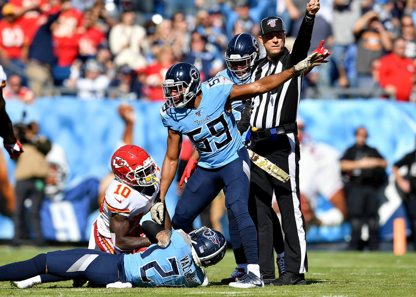 The official and Tennessee Titans inside linebacker Wesley Woodyard (59) call an interception, but it was overturned, during the first half of the NFL football game between the Titans and the Kansas City Chiefs Sunday, Nov. 10, 2019, at Nissan Stadium in Nashville, Tenn.