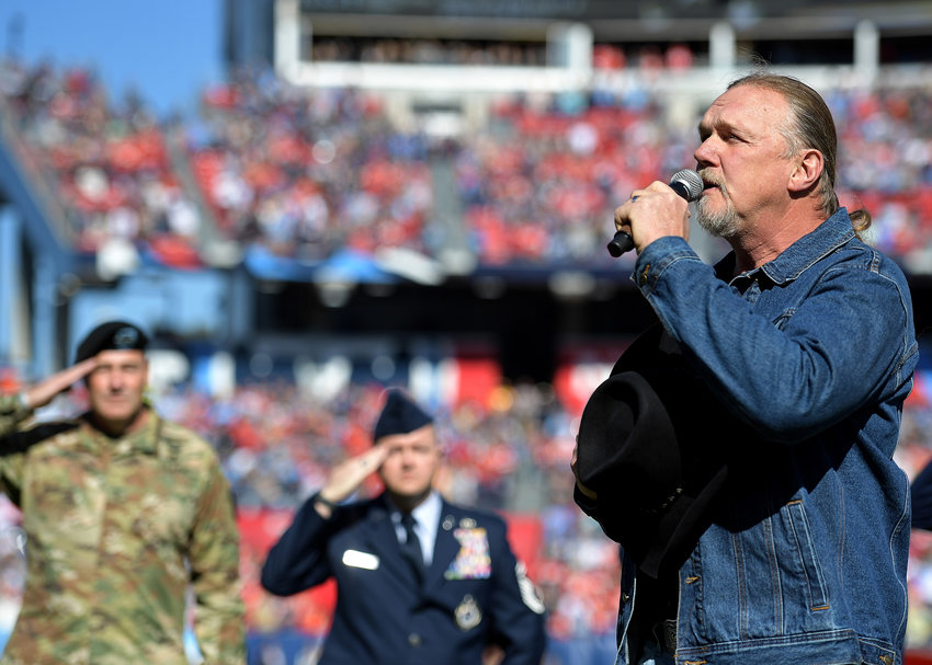 Country music artist Trace Adkins sings the national anthem prior to the start of the NFL football game between the Tennessee Titans and the Kansas City Chiefs Sunday, Nov. 10, 2019, at Nissan Stadium in Nashville, Tenn.