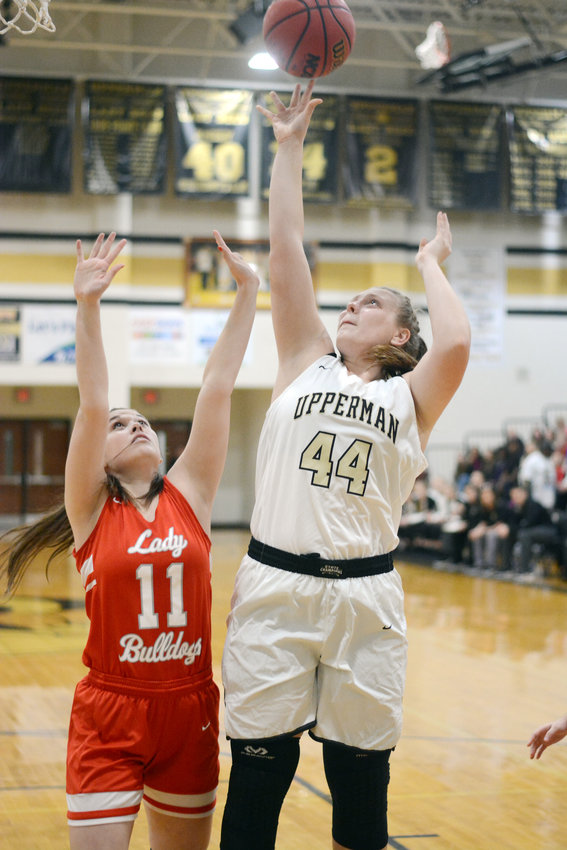 Upperman's Abigail Johnson, right, goes up for a layup during the Lady Bees' 66-38 win over Red Boiling Springs Saturday at UHS.